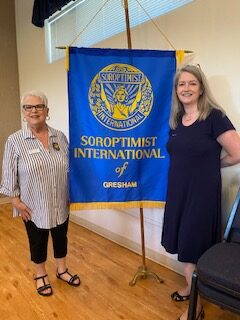Peggy & Tami with Banner